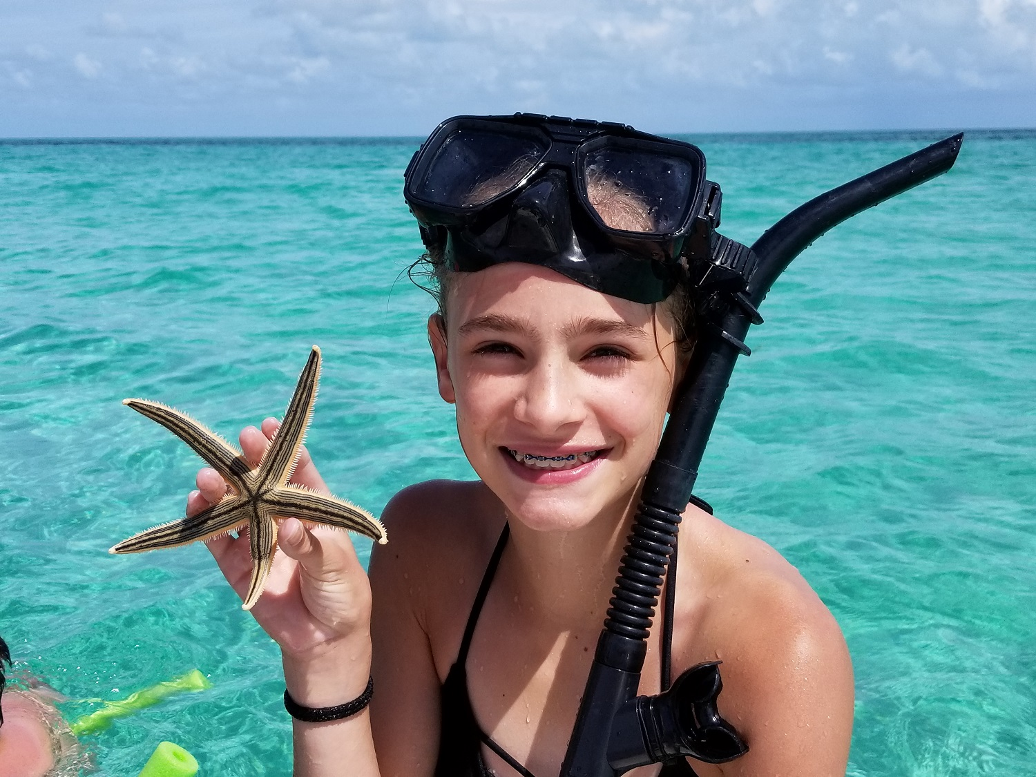 Girl with star fish snorkeling in Key West